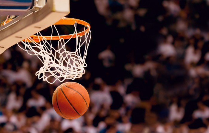 Basketball going in basket