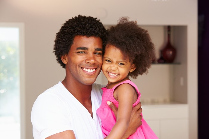 Black Dad with Daughter