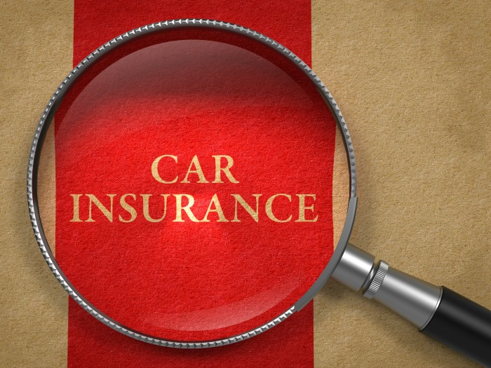 Car Insurance under a magnifying glass