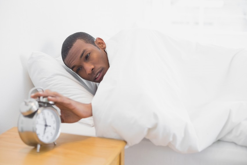 Man Hitting the Snooze Button