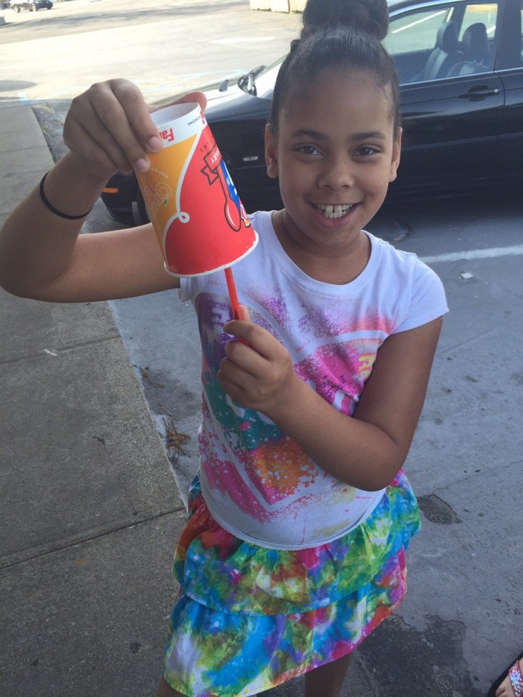 Daughter Holding Blizzard from Dairy Queen #GetUpsideDown