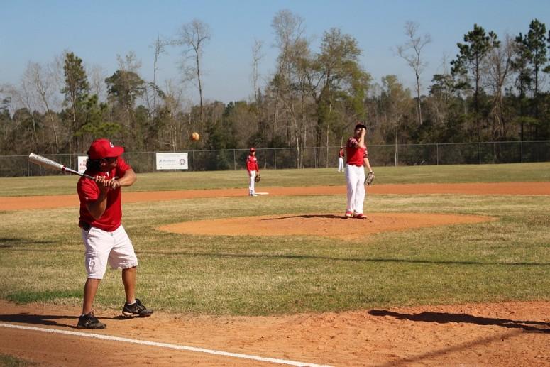 Man Hitting Baseball